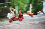 children down hill having fun